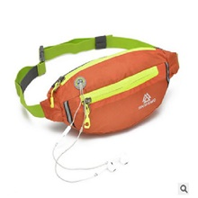 fanny packs for women - slim yet spacious waist pack w/ multiple compartments and headphone cord access - lightweight fannie hip bag great for hiking, walking, biking, running, travel, & more orange,5.5 inch